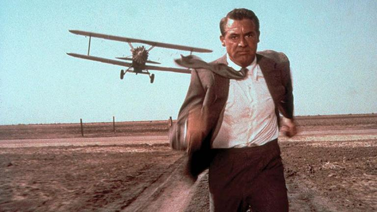 Photograph from North by Northwest (1959). Cary Grant (as Roger Thornhill) flees from a biplane in an iconic scene from the film