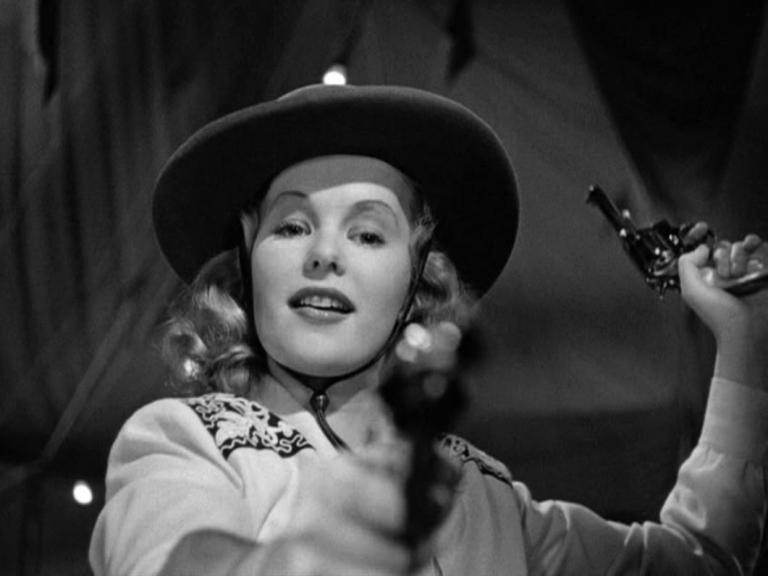 Annie Laurie Starr (Peggy Cummins) brandishes a pair of pistols in a scene from the 1950 film, Gun Crazy