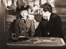 Joan Greenwood (as Christine Minetti) and Derrick de Marney (as Charles Garrie) in a screenshot from Latin Quarter (1945) (2)