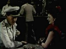 Wendell Corey (as Captain Davidson) and Margaret Lockwood (as Laughing Anne) in a screenshot from Laughing Anne (1953) (2)