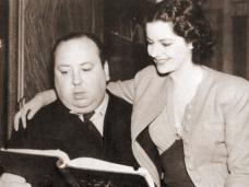 Margaret Lockwood puts her arm around famous British director, Alfred Hitchcock