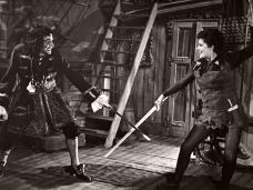 Photograph of John Justin as Capt Hook and Margaret Lockwood as Peter Pan in the Scala Theatre, 1950 production run of Peter Pan