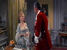 Joan Greenwood (as Lady Ashwood) and Stewart Granger (as Jeremy Fox) in a screenshot from Moonfleet (1955) (4)