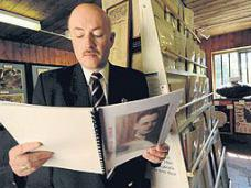 Volunteer at the RAF Oulton Museum, Blickling Hall, Norfolk, Mark Stocking reads about a pilot who flew from RAF Oulton