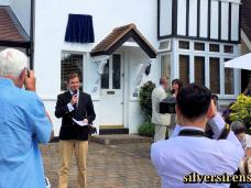 Richard Williams, 1940s film buff and owner of 'Silver Sirens – The Golden Age of British Cinema', gives a speech about Margaret Lockwood at the unveiling of a commemorative blue plaque at 34, Upper Park Road, Kingston.  Actresses Julia Lockwood and Vicki Michelle watch from the front garden.  Saturday, 4th July, 2015.