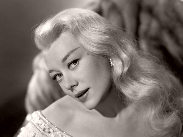Glynis Johns, in the dual role of Caroline/Miranda Trewella, strikes a sexy pose in a publicity shot from Mad About Men (1954)