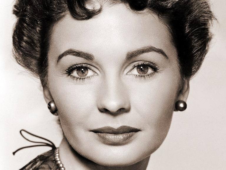 Jean Simmons, British actress, wears a lacy top and a pearl necklace as she poses for a 1950s publicity photo