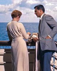 Photograph from An Affair to Remember (1957) featuring Deborah Kerr (as Terry McKay) and Cary Grant (as Nickie Ferrante). The pair are chatting by the railings of a cruise ship at sea