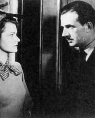 Margaret Lockwood (as Helene Ardouin) and Hugh Sinclair (as Inspector Calas) in a photograph from Alibi (1942) (4)