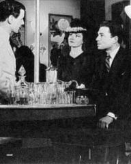 Margaret Lockwood (as Helene Ardouin) and James Mason (as Andre Laurent) in a photograph from Alibi (1942) (5)