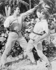 Stewart Granger (as Mark Shore) and James Whitmore (as Fetcher) in a photograph from All the Brothers Were Valiant (1953) (1)