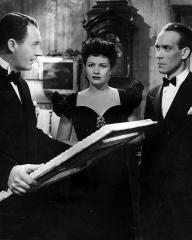 Ian Hunter (as Charlie Carrington), Margaret Lockwood (as Bedelia Carrington) and Barry K Barnes (as Ben Chaney) in a photograph from Bedelia (1946) (18)