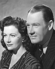 Margaret Lockwood (as Bedelia Carrington) and Ian Hunter (as Charlie Carrington) in a photograph from Bedelia (1946) (25)