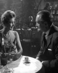 Patricia Roc (as Mme. Dueaux) and George Sanders (as Landru) in a screenshot from Bluebeard's Ten Honeymoons (1960) (1)