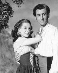 Jean Kent (as Rosal) and Stewart Granger (as Richard Darrell) in a photograph from Caravan (1946) (1)