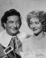 Sid Field (as Sidcup Buttermeadow) and Margaret Lockwood (as Nell Gwynne) in a photograph from Cardboard Cavalier (1949) (24)
