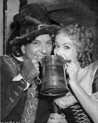 Sid Field and Margaret Lockwood share a tankard of ale during a cheeky moment away from the cameras during the filming of Cardboard Cavalier