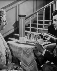 Mona Washbourne (as Monica Bare) and Dirk Bogarde (as Edward Bare) in a photograph from Cast a Dark Shadow (1955) (17)