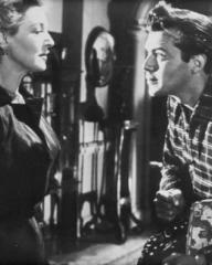 Kay Walsh (as Charlotte Young) and Dirk Bogarde (as Edward Bare) in a photograph from Cast a Dark Shadow (1955) (29)