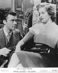 Dirk Bogarde (as Edward Bare) and Margaret Lockwood (as Freda Jeffries) in a photograph from Cast a Dark Shadow (1955) (4)