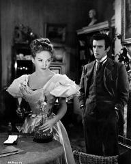 Joan Greenwood and George Cole share a scene in the film 'Flesh And Blood', directed by Anthony Kimmins for British Lion