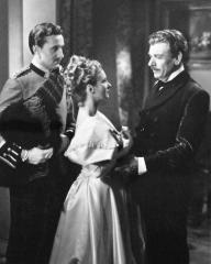 Patrick Macnee (as Sutherland) and Joan Greenwood (as Wilhelmina Cameron) in a photograph from Flesh and Blood (1951) (4)