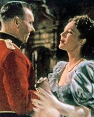 Ralph Richardson (as Capt John Durrance) and June Duprez (as Ethne Burroughs) in a colour photograph from The Four Feathers (1939) (1)