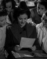 Margaret Lockwood (as Leslie James) in a screenshot from A Girl Must Live (1939) (1)