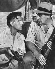 Stewart Granger (as Rian X. Mitchell) and Paul Douglas (as Vic Leonard) in a photograph from Green Fire (1954) (1)
