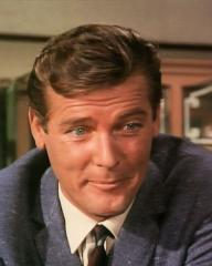 Screenshot from the 1966 'The House on Dragon's Rock' episode of The Saint (1962-1969) (2) featuring Roger Moore