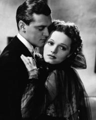 Hugh Williams (as Jim Wyndham) and Linden Travers (as Helen Norwood Bernardy) in a photograph from Brief Ecstasy (1937)
