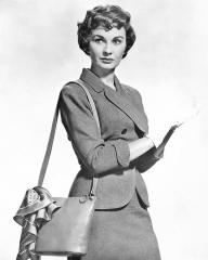 Jean Simmons as Sergeant Sarah Brown wears white gloves in a publicity shot for the film Guys and Dolls, from 1955.
