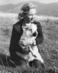 Joan Greenwood cradles a lamb