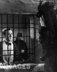 Joan Greenwood (as Sibella) and Dennis Price (as Duke Louis Mazzini/ Mazzini Sr./ Narrator) in a photograph from Kind Hearts and Coronets (1949) (14)