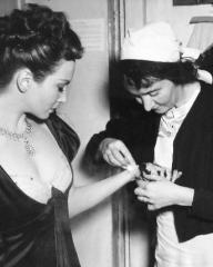 Joan Greenwood receives first aid while on set of the 1948 film, The Bad Lord Byron