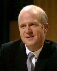 Sir John Gallagher (Philip Stone) discusses the case in Justice. Season 1, episode Witnesses Cost Extra