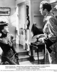 Joan Greenwood (as Sibella) and Dennis Price (as Duke Louis Mazzini/ Mazzini Sr./ Narrator) in an Argentine photograph from Kind Hearts and Coronets (1949) (16)