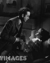 Dennis Price as Louis Mazzini and Joan Greenwood as Sibella in the film 'Kind Hearts And Coronets', directed by Robert Hamer and produced by Ealing Studios