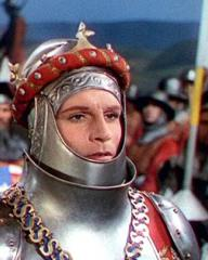 On the eve of battle, King Henry V (Laurence Olivier) in armour parleys with Mountjoy, the French Herald
