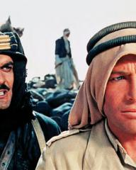 Omar Sharif (Sherif Ali) looks menacingly at the back of Peter O'Toole (T.E. Lawrence)