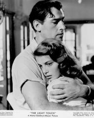 Stewart Granger (as Sam Conride) and Pier Angeli (as Anna Vasarri) in a photograph from The Light Touch (1952) (1)