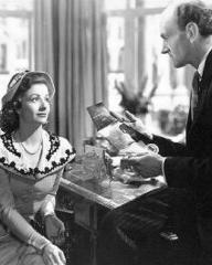 Margaret Lockwood (as Ann Markham) and Maurice Denham (as Fosser) in a photograph from Look Before You Love (1948) (10)