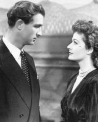 Norman Wooland (as Ashley Morehouse) and Margaret Lockwood (as Ann Markham) in a photograph from Look Before You Love (1948) (11)