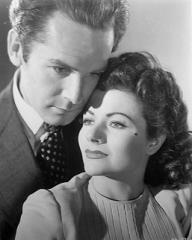 Griffith Jones (as Charles Kent) and Margaret Lockwood (as Ann Markham) in a photograph from Look Before You Love (1948) (17)
