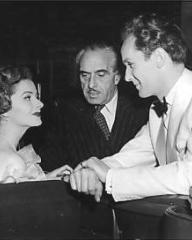 Margaret Lockwood chats with director Harold Huth and co-star Griffith Jones during a break from filming Look Before You Love