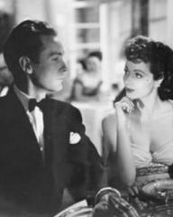 Griffith Jones (as Charles Kent) and Margaret Lockwood (as Ann Markham) in a photograph from Look Before You Love (1948) (7)