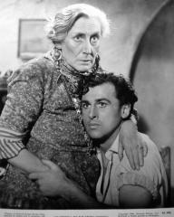 Nancy Price (as Mama Barucci) and Stewart Granger (as Nino Barucci) in a photograph from Madonna of the Seven Moons (1944) (1)