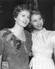 Mother and daughter (Margaret Lockwood and Julia Lockwood) smile happily as they perform together in Peter Pan at the Scala Theatre, London, in 1957.  Margaret plays Peter Pan and Julia Wendy