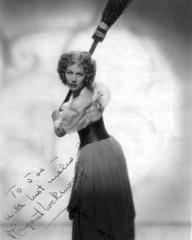 Margaret Lockwood as Nell Gwynne aims to strike with a broom in a signed publicity photo from Cardboard Cavalier