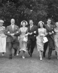 Margaret Lockwood and members of the cast and crew of Jassy let their hair down for the camera during a break from filming
